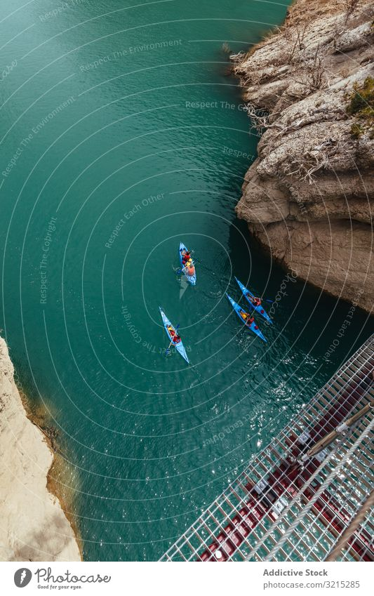 People crossing a river by kayak water people lifestyle sports kayaking travel landscape recreation activity boat summer rowing nature tourism blue boats sky