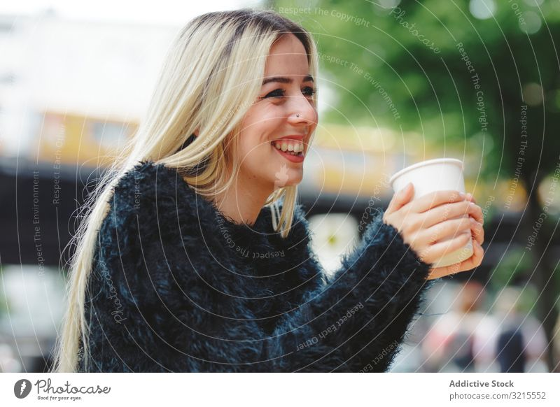 Beautiful woman drinking coffee in street cafe berlin blonde cheerful smile young beautiful fashion stylish elegant attractive casual hair model female trendy