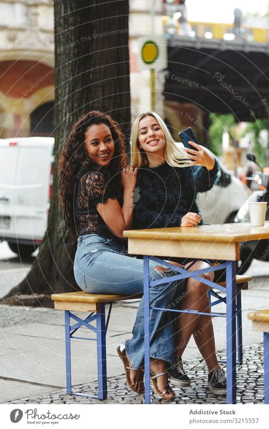 Friends taking selfie in street cafe woman friend talk berlin beautiful smile happy together leisure enjoyment restaurant female multiracial pretty conversation