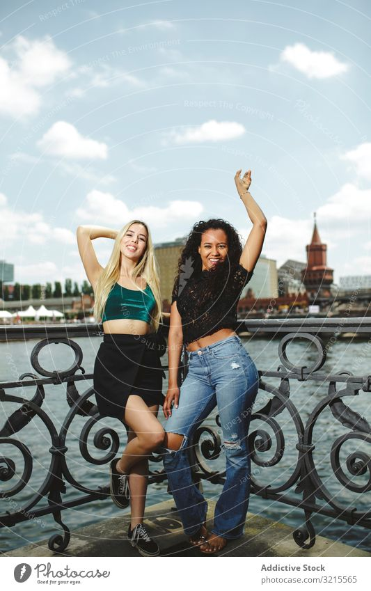 Cheerful friends on city river woman street berlin summer together bonding smile cheerful young happy girlfriend beautiful sunny trendy casual stylish pretty