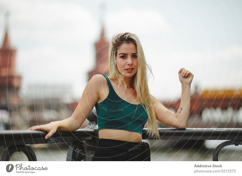 Beautiful blonde woman leaning on railing model beautiful berlin young fashion stylish trendy female gorgeous elegant urban charming feminine sightseeing city