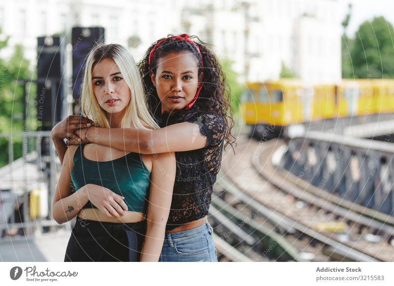 Friends standing on train platform woman friend beautiful berlin sunny young together summer trendy bonding casual stylish pretty multiracial multiethnic urban