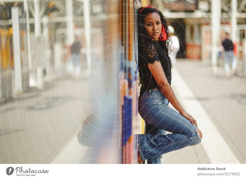 Cheerful black woman standing on train beautiful berlin smile sunny young cabin summer trendy driver casual journey stylish ethnic pretty travel warm relax trip