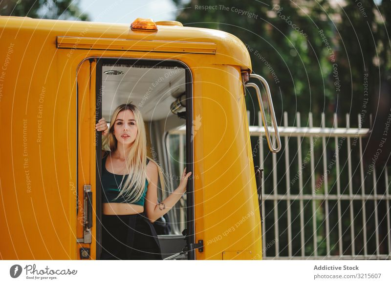 Cheerful blonde woman standing on train in drivers cabin beautiful berlin smile sunny young summer trendy casual journey stylish pretty travel warm relax trip