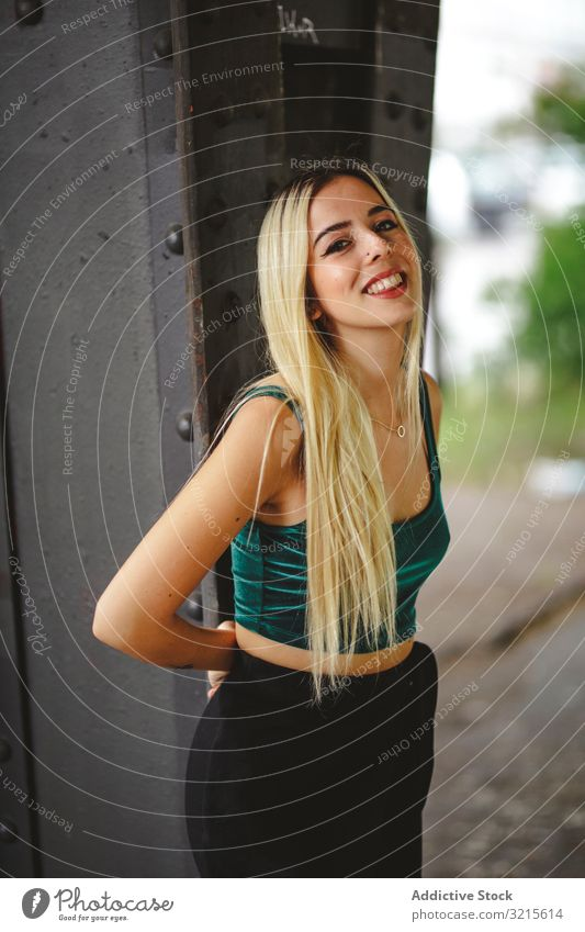 Blonde cheerful model standing and looking at camera woman berlin blonde smile young beautiful fashion stylish slim elegant attractive casual hair female trendy