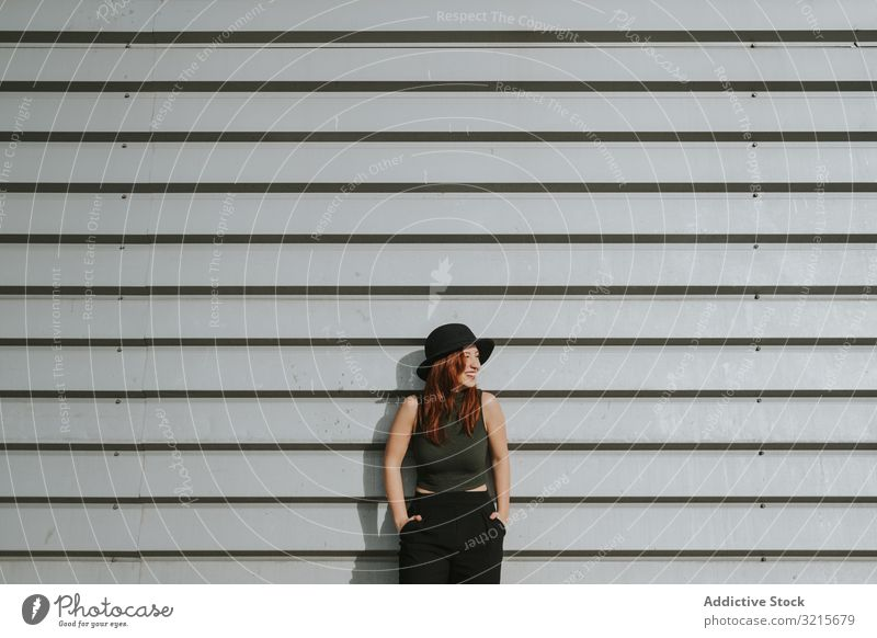 Woman leaning on wall woman sensual model attractive hat stylish fashion young happy elegant lifestyle beautiful female fashionable trendy gorgeous charming