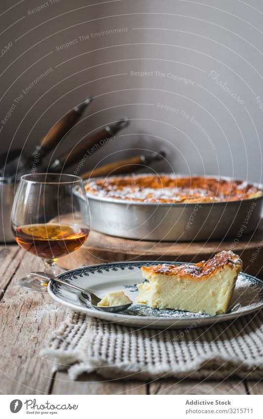 Cottage cheese pudding and glass of cognac casserole brandy baked cooking food beverage alcohol cottage dessert homemade piece prepared delicious appetizing