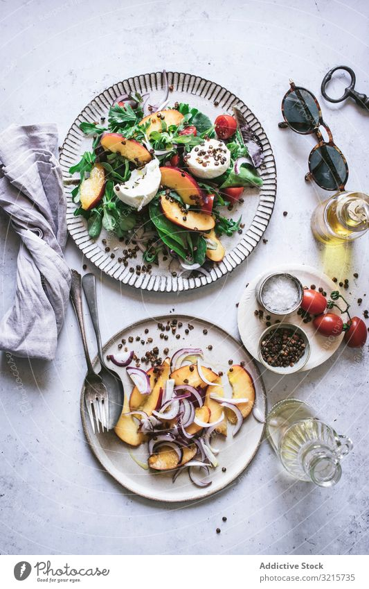 Salad with nectarines and crunchy lentils salad peach onion tomato cherry lettuce cheese pepper slice salt red black food spice vegetarian delicious healthy