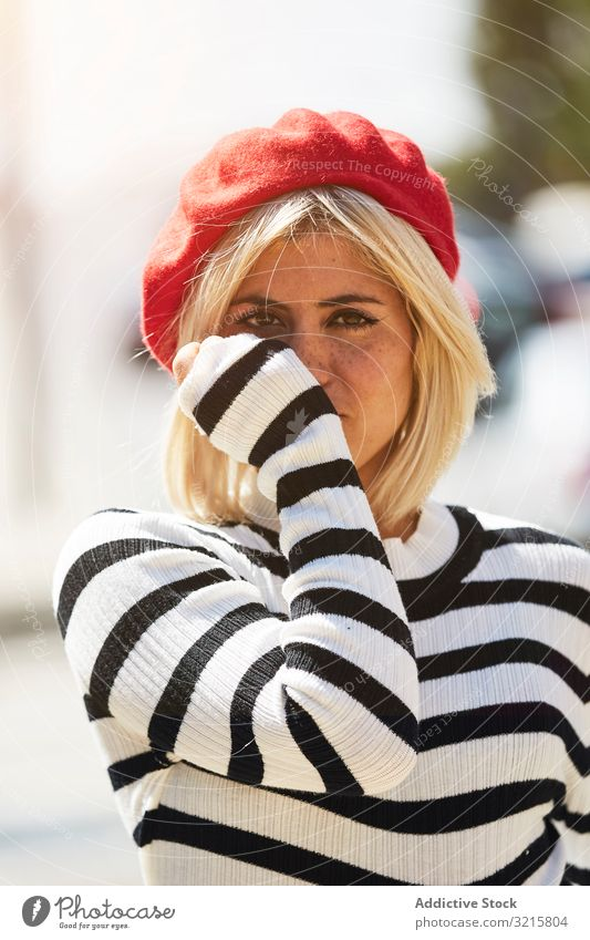 Beautiful female in red beret outdoors woman stylish trendy striped french fashion glamorous young person attractive beautiful casual blonde freckle pretty