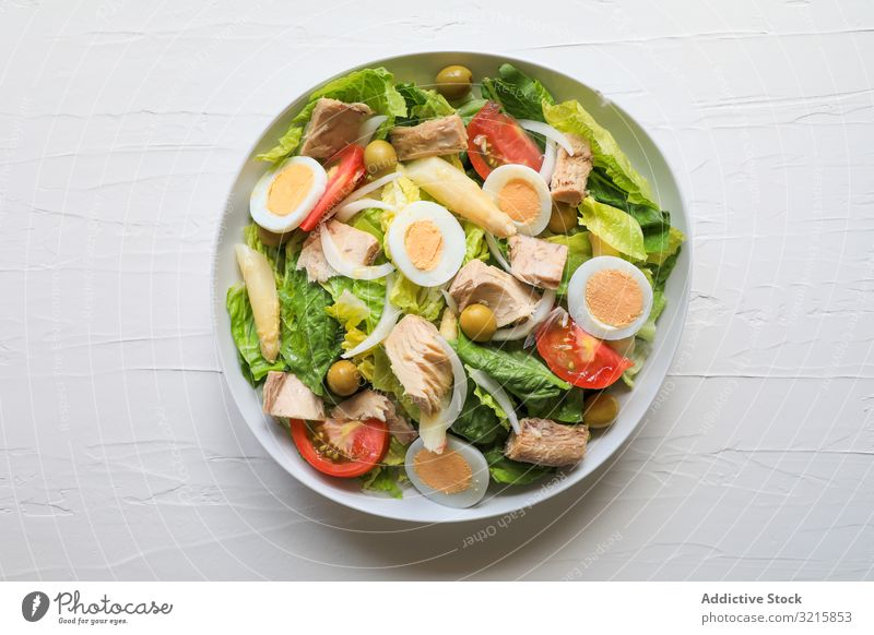 Delicious colorful summer salad tuna lettuce tomato egg olive onion food fish healthy delicious vegetable fresh appetizing bowl green red yellow recipe dish