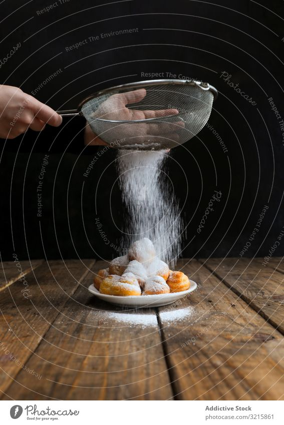 Person sprinkling icing sugar over on cookies sprinkle food biscuit pastry sieve homemade chef sweet delicious powder bakery decorating dessert cake snack fresh