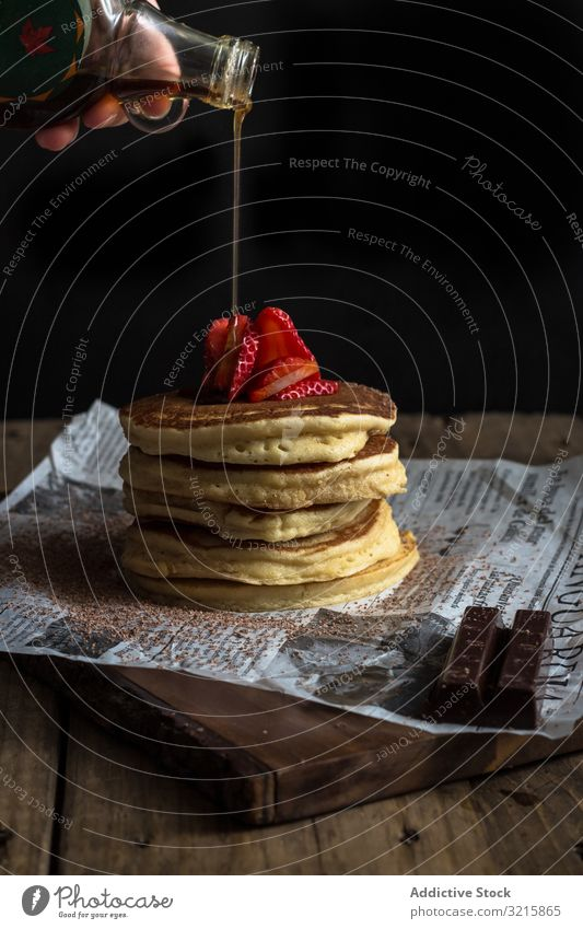 Pancake with strawberries and chocolate covered in syrup pancake strawberry topping breakfast garnish tasty prepare food gourmet sweet meal delicious pour