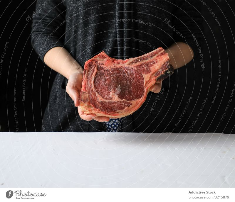 Big piece of fresh meat on bone appetizing cooking raw food protein red uncooked cow butcher preparation ingredient butchery cut beefsteak freshness rustic