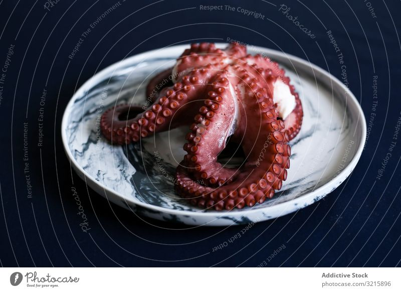 Red fresh fleshy octopus in white plate seafood tasty delicatessen appetizing dinner luxury ingredient natural omega freshness delicacy frozen eating oceanic