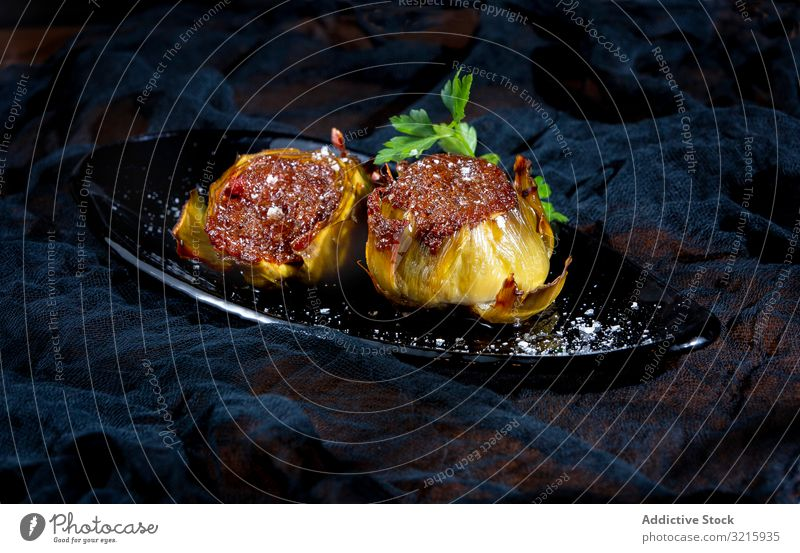 Delicious baked artichokes on black plate stuffed salt food sprinkling delicious tasty cooked gourmet homemade fresh appetizer vegetable filling cuisine meal