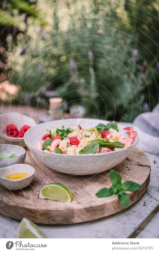 Tasty salad on wooden stand served on decorated table outside tasty meal food healthy dinner berry lime fresh delicious cuisine gourmet vegetable diet dish