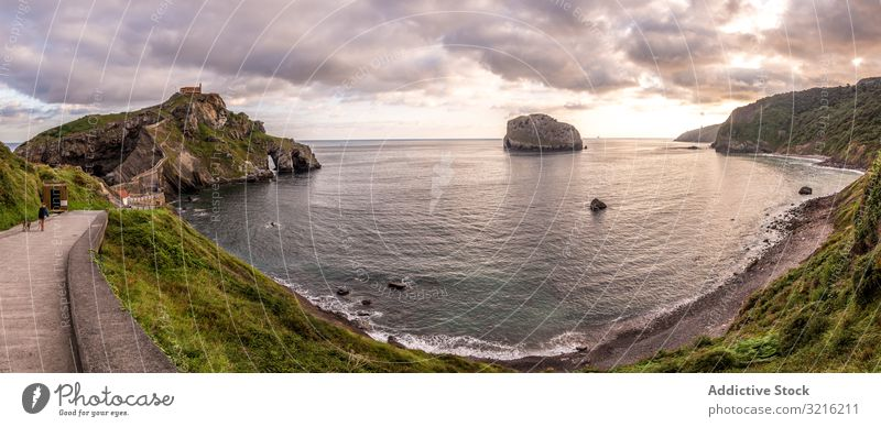 Panoramic view of beautiful bay and cloudy sky panoramic seaside touristic path calm water beach coast landscape nature summer travel vacation tourism coastline