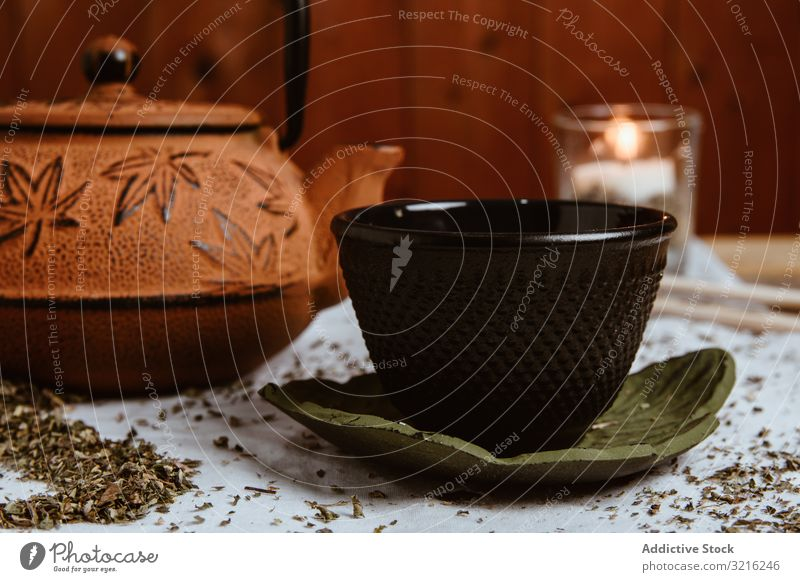 Aromatic tea dates and clay teapot on table leaves herbal drink green hot natural traditional beverage bowl oriental antioxidant gourmet ceremony ramadan teacup