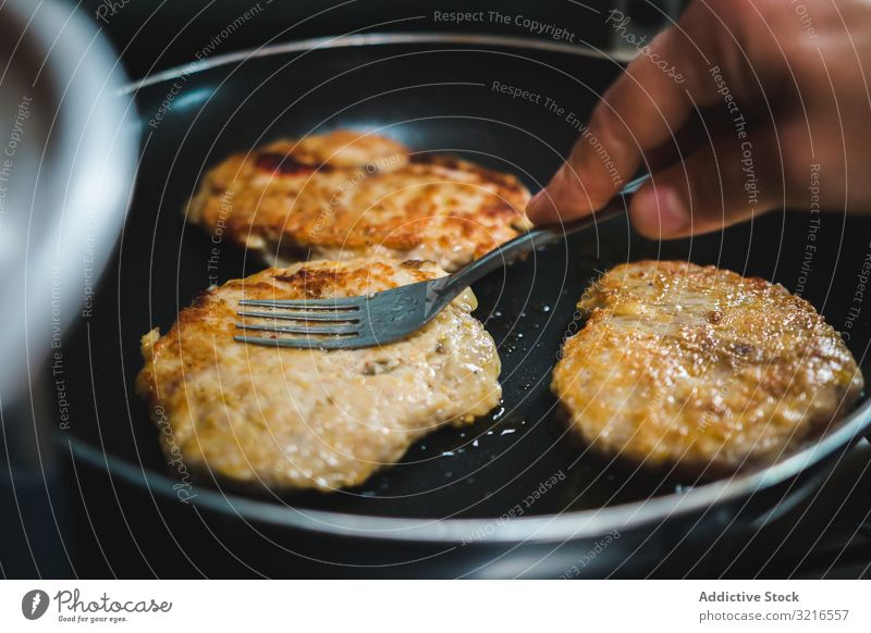 Meat cutlets frying on pan oil hot kitchen cook meat food meal dinner lunch pork chicken roast delicious tasty yummy delectable palatable savory scrumptious
