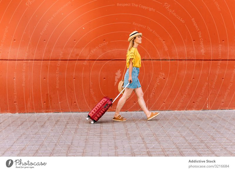 Young woman traveler going on holiday adventure suitcase tourist freedom journey lifestyle wanderlust vacation trip walking explore relax activity sightseeing