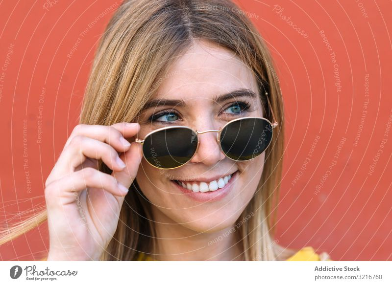 Beautiful woman in sunglasses smiling at camera eyes posing model beautiful fashion deep style young female blue blonde happy joy summer trendy smile cheerful