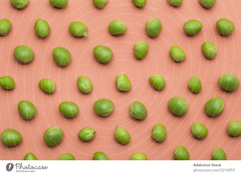 Set of peas placed orderly on salmon colored background clip ecological flat lay food fresh green healthy legume natural organic pod raw seed set vegetable
