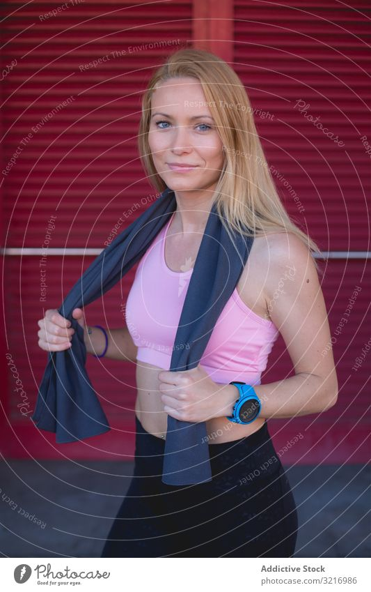 Woman resting from running woman active athletic beautiful blonde body cardio caucasian female exercise fitness gym healthy jog lifestyle outdoors slim sport