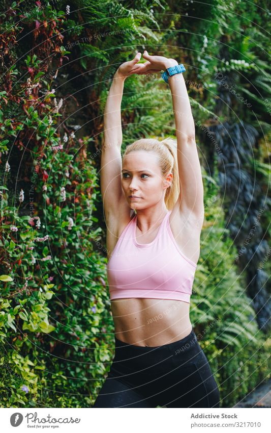 Woman doing some elongation exercises active athletic beautiful blonde body cardio caucasian fitness gym healthy jog lifestyle outdoors resting runner slim