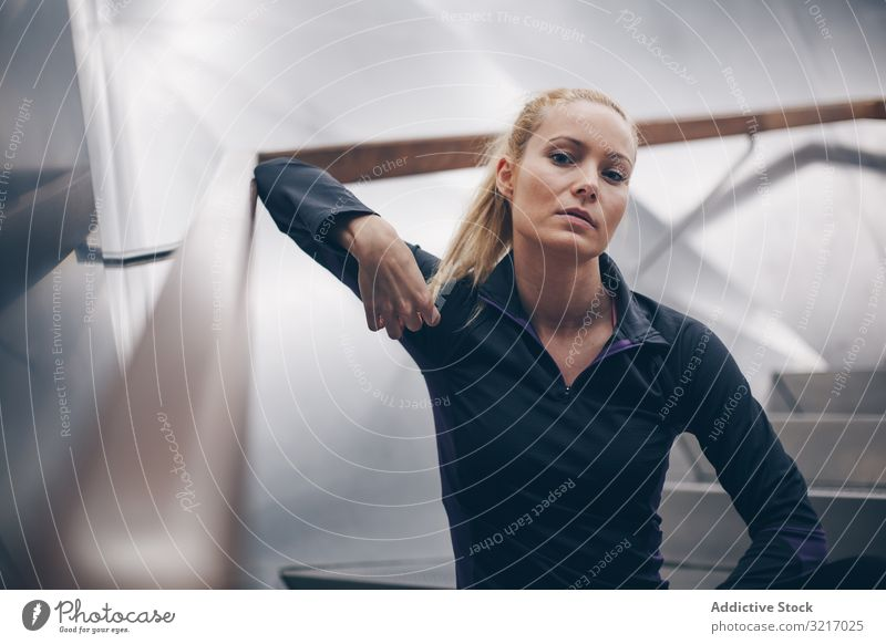 Portrait of a woman with sportswear active athletic beautiful blonde body cardio caucasian exercise fitness gym healthy jog lifestyle metal mirror outdoors