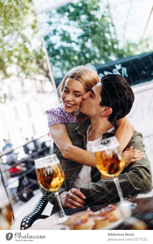 Happy young couple drinking beverages outdoors happy cheerful woman enjoying refreshing walking town beer girlfriend boyfriend love flirting lifestyle dating