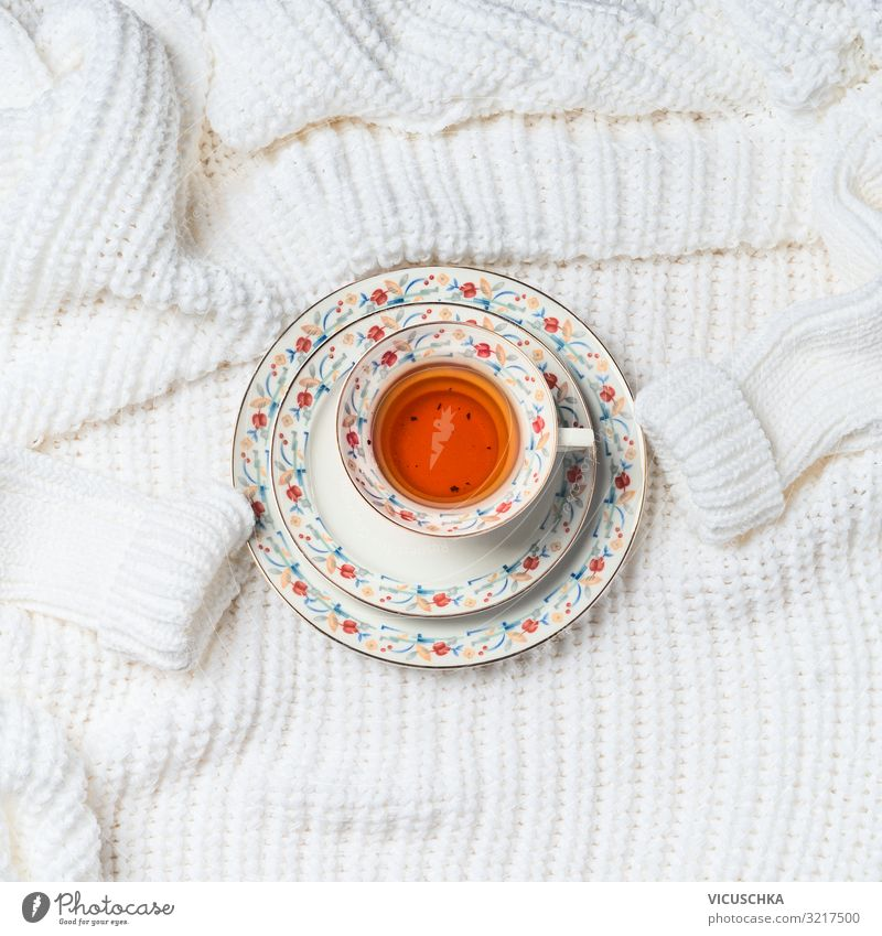 Cup of tea on knitted cardigan Beverage Hot drink Tea Lifestyle Style Design Winter Living or residing Sweater Background picture White Knitted Colour photo