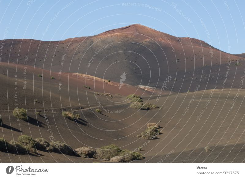 Landscape in Timanfaya National Park. Lanzarote. Canary Islands. Spain. Mountain Nature Sand Hill Peak Volcano Desert Natural arid Canaries desertic dry