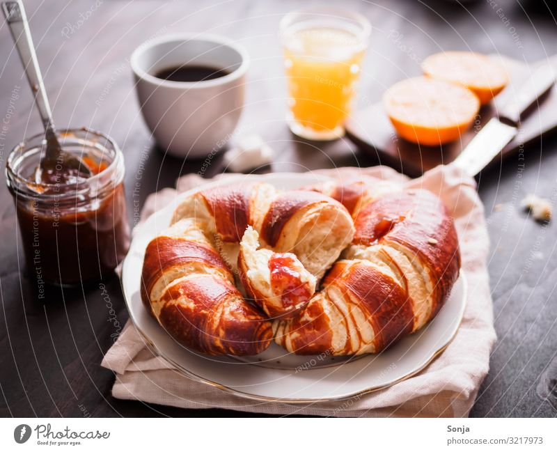 Breakfast with croissant and coffee Food Fruit Orange Dough Baked goods Croissant Jam Beverage Hot drink Juice Coffee Plate Cup Glass Knives Fragrance Eating