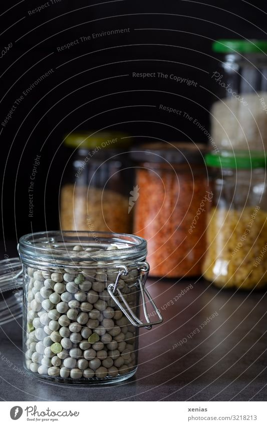 bottled peas in open glass containers in front of other storage jars Peas Preserving jar Supply Noodles Lentils Organic produce Shopping Glass container Modern