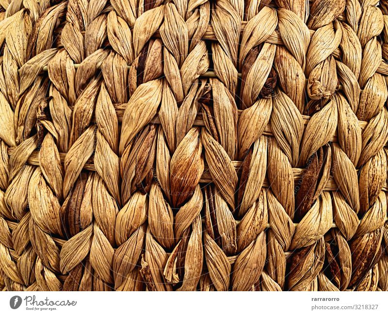 close-up view of a straw basket. Design Handicraft Furniture Craft (trade) Container Braids Wood Old Natural Retro Brown braided Basket wicker knots Self-made