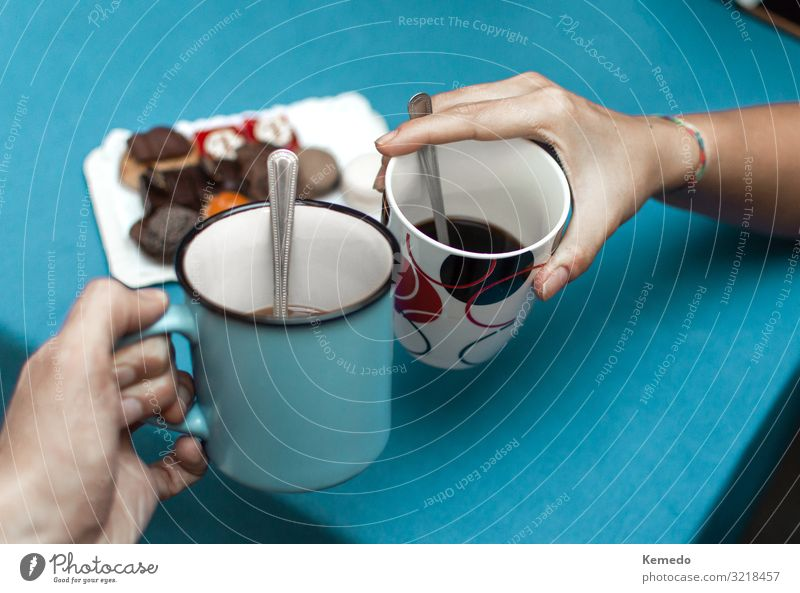 Friends make a toast with cups of coffee before eat pastries. Woman Human being Youth (Young adults) Man Blue Hand House (Residential Structure) Joy Black