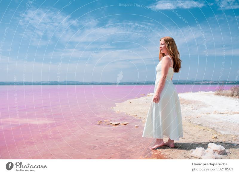 Side view of cute teenager woman wearing summer clothes on pink lake young saline romantic white tourism happy alone sea colorful nature water copy space salty