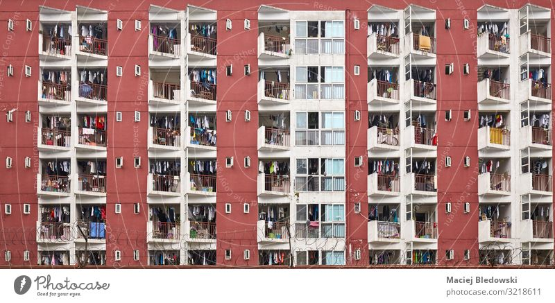 Residential apartment building with drying laundry. Lifestyle Living or residing Flat (apartment) House (Residential Structure) House building Town Downtown