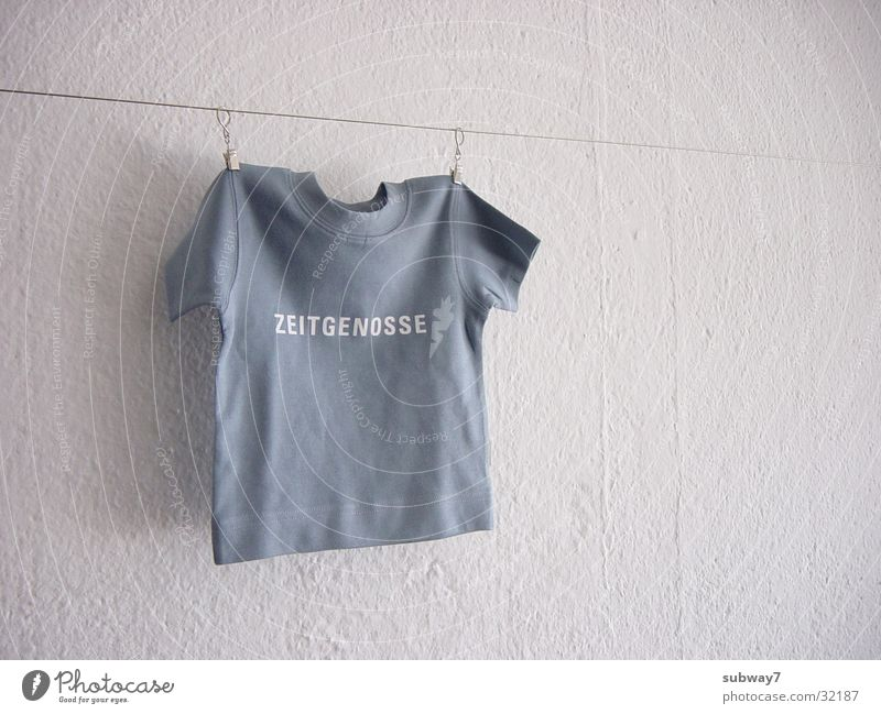 Wall (building) Leisure and hobbies Rope Characters Clothing T-shirt Letters (alphabet) String Shirt Wire Clothesline Symbols and metaphors Agency Wire cable