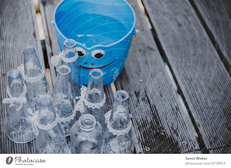 Blue bucket with face Plastic Happy Glass Bottle loop belt White Bucket Face Wood Floor covering Wet Colour photo Multicoloured Exterior shot Close-up