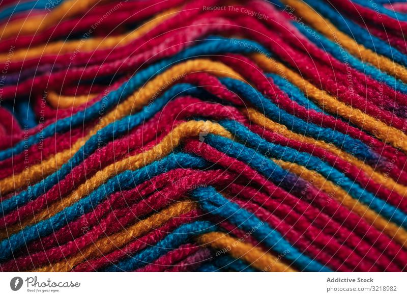 Multicolored wool threads texture multicolored natural fiber warm yarn soft decorative craft hobby knitting clothes textile handicraft creativity colorful woven