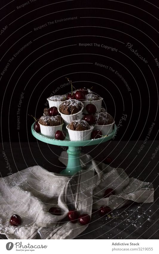 Plate with cupcakes and cherries cherry chocolate plate napkin heap sweet dessert fresh treat snack fruit berry food delicious tasty yummy scrumptious muffin