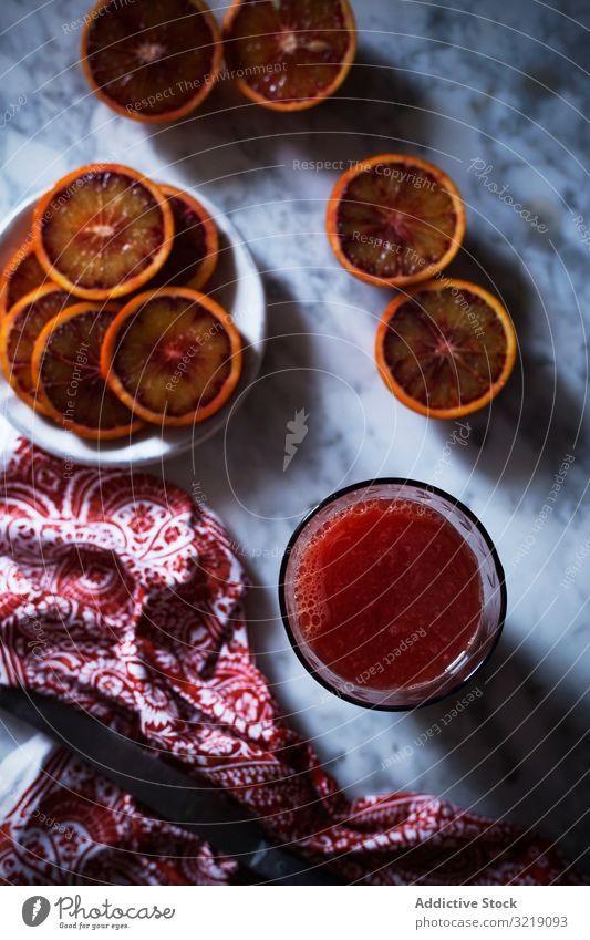 Drink made of blood orange drink fruit healthy napkin table juice diet glass slice citrus beverage fresh vitamin vegan vegetarian food smoothie cloth fabric