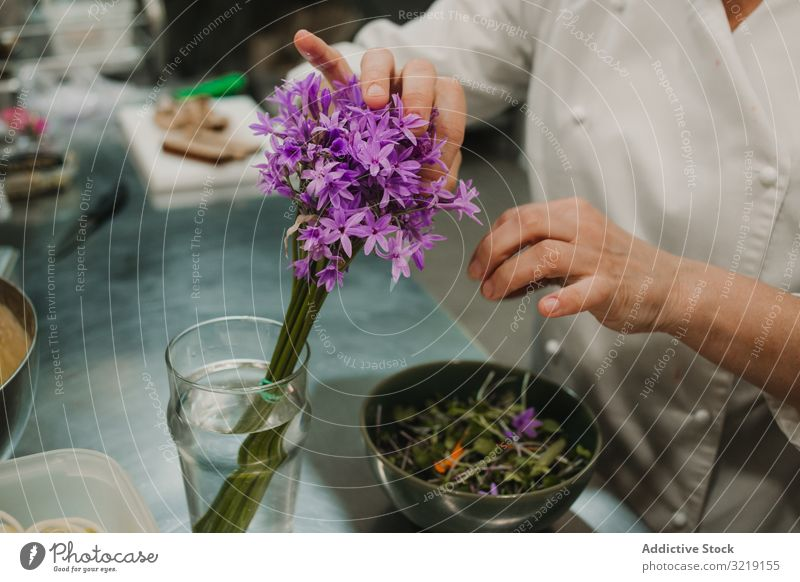 Woman preparing salad by hands at decorated table vegetable green chef dish food fresh dinner red gourmet homemade restaurant organic cooking nutrition tasty