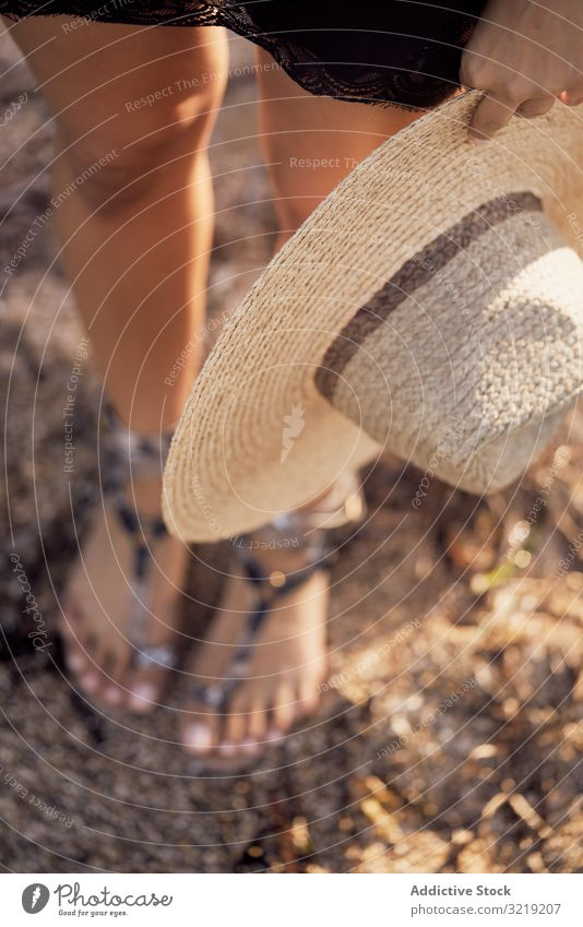 From above woman holding hat in hand summer accessory fashion stylish trendy relax travel vacation holiday straw rest nature standing beach boho tourism clothes