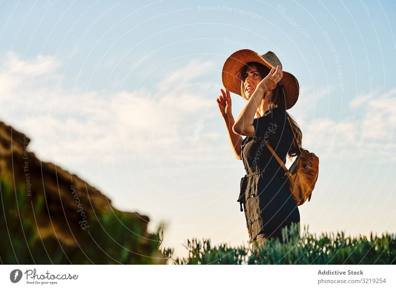 Woman traveler in straw hat walking woman tourist vacation summer backpack field journey adventure female holiday nature hiker boho wanderlust freedom