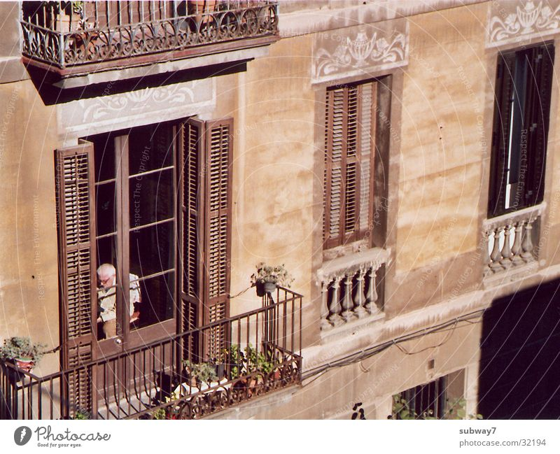 Man City Senior citizen House (Residential Structure) Window Building Facade Balcony Spain Boredom Retirement Window pane Barcelona Neighbor Old building