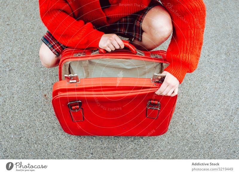 Woman opening suitcase on road woman red travel stylish female luggage hide beautiful bag freedom alone urban trip journey bush enjoyment pleasure model tourist