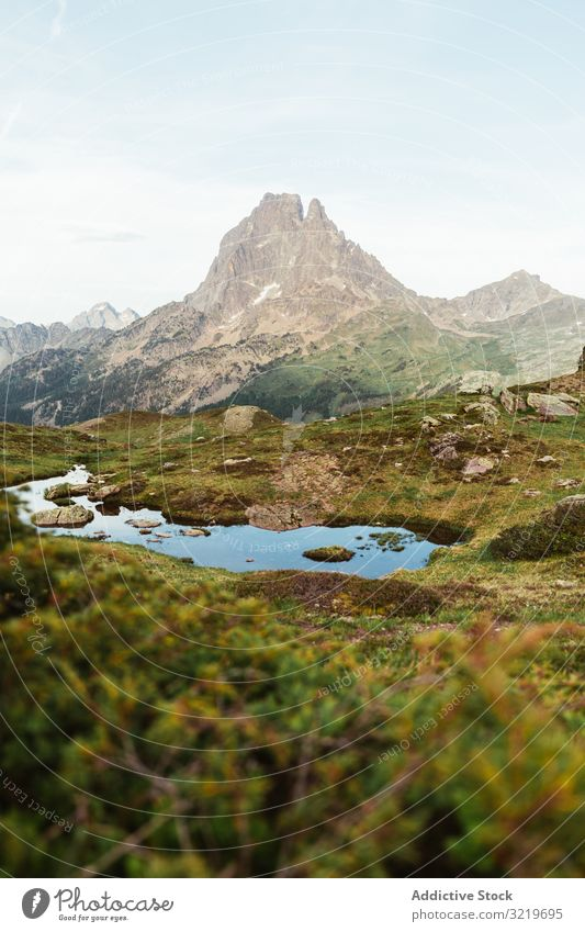 Picturesque view of lake in mountain area pyrenees lawn travel picturesque beautiful calm stony sunny day water landscape summer nature scenic countryside rocky