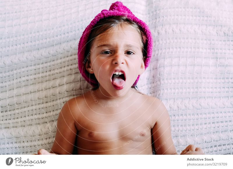 Child in turban on the couch kid sofa home child fun childhood lifestyle sitting room cute little modern small barefoot casual enjoying lovely contemporary